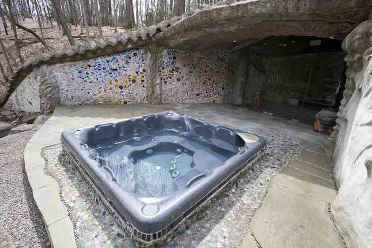 As You Begin To Work Your Way In, Youu0027ll Find This Lovely Hot Tub,  Surrounded By Walls With Rainbow Colored Glass Work.